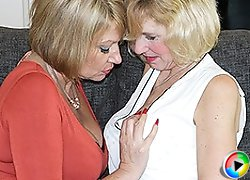 Two naughty British housewives licking eachother