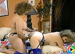 Grey-haired lesbian granny in sexy blue stockings strapon-fucked by her old kinky girlfriend