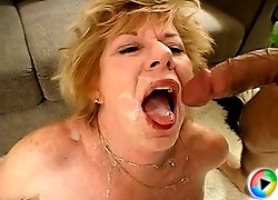 Sexy granny gets her pussy and throat drilled by two firm cocks and takes a double facial