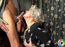 Blonde granny fucks her lover in the parlor