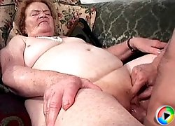 Stuffing a horny old slut's pussy