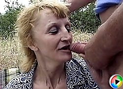 Dirty blonde gets nailed in an outdoor threesome