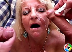 The mature pussy hole is fucked by the young men and they jizz her face so very well