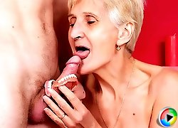 Naughty gray haired mature Irine removes her set of dentures to dish out a hot blowjob