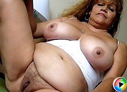 This big titted mature slut loves playing with herself